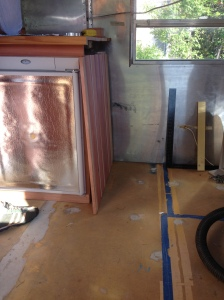 Fridge of left; to be built bed/cabinet on right. Needed a cabinet that fits in the middle.