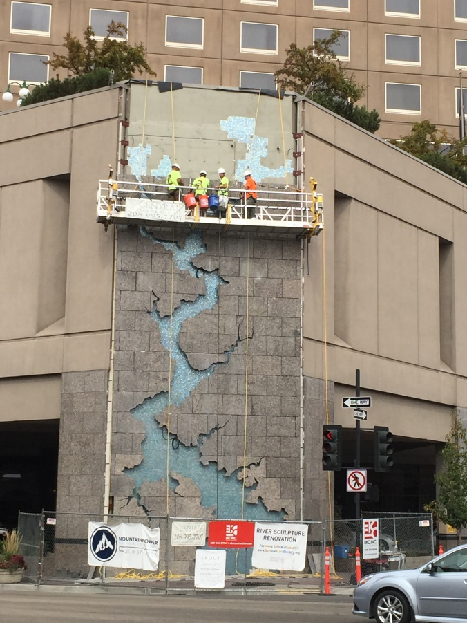A piece of art depicting the Boise River, in progress of installation on a building downtown!